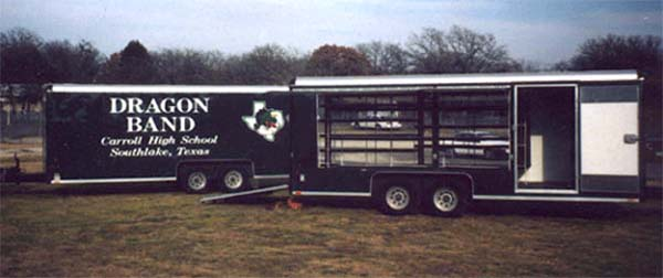 Two customized band trailers